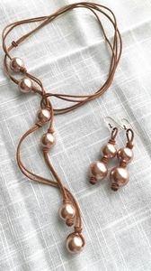 Lariat rose pearl necklace earring set on cord